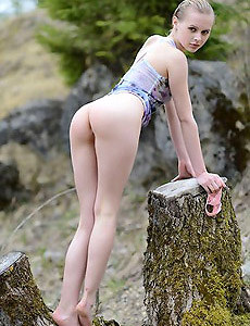 Naked girl walking in forest