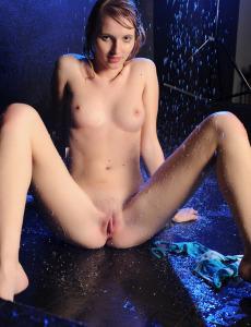 Blonde goddess in blue bikini and raindrops